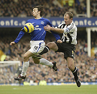 Photo: Aidan Ellis.<br /> Everton v Newcastle. The Barclays Premiership.<br /> 27/11/2005.<br /> Newcastle's Alan Shearer challenges Everton's Simon Davis