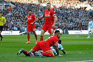 Nathaniel Clyne of Liverpool knocks over Raheem Sterling of Manchester City. Capital One Cup Final, Liverpool v Manchester City at Wembley stadium in London, England on Sunday 28th Feb 2016. pic by Chris Stading, Andrew Orchard sports photography.