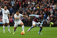 Jefferson Montero of Swansea city holds off Jordan Ayew of Aston Villa. Barclays Premier league match, Aston Villa v Swansea city at Villa Park in Birmingham, the Midlands on Saturday 24th October 2015.<br /> pic by  Andrew Orchard, Andrew Orchard sports photography.