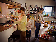 Three generations cook together in their beautiful Tuscan kitchen in Italy.