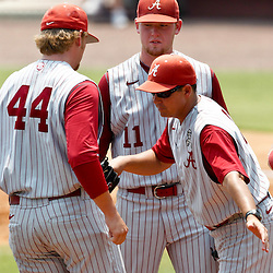 June 06, 2011; Tallahassee, FL, USA; Alabama Crimson Tide head coach Mitch Gaspard pulls pitcher Trey Pilkington (11) for reliever Tucker Hawley (44) during the eighth inning of the Tallahassee regional of the 2011 NCAA baseball tournament as play resumed following the suspension of play due to severe weather last night at Dick Howser Stadium. Florida State defeated Alabama 11-1 to advance to a super regional.  Mandatory Credit: Derick E. Hingle