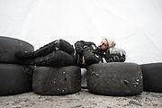 January 30-31, 2016: Daytona 24 hour: A mechanic sleeps on tires and helmet during the 24 hours of Daytona