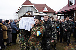 © Licensed to London News Pictures. 24/02/2014. Ukraine, The funeral of Igor Dmytriv, an activist killed by a snipers bullet in Kyiv. Here, Igor's body  leaves his native village of Kopanky . Photo credit : Christopher Nunn/LNP