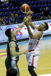 QUEZON Quezon City, May 13, 2017  Chan Kek Thai of Malaysia (L) competes against Firman Dwi Nugroho of Indonesia (R) during their match in the 2017 SEABA senior men's championship tournament in Quezon City, the Philippines, May 13, 2017. Indonesia won 63-42. (Credit Image: © Rouelle Umali/Xinhua via ZUMA Wire)
