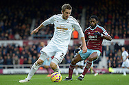 Gylfi Sigurdsson of Swansea City in action. Barclays Premier league match, West Ham Utd v Swansea city at the Boleyn ground, Upton Park in London on Sunday 7th December 2014.<br /> pic by John Patrick Fletcher, Andrew Orchard sports photography.