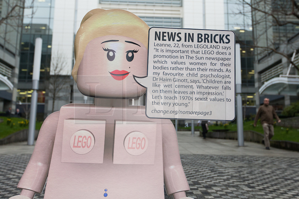 © Licensed to London News Pictures. 26/02/2013. London, UK. A spoof female Lego model outside The Sun's News International offices in Wapping, East London on 26 February 2013. Demonstrators are calling for Rupert Murdoch to end topless female models in The Sun newspaper, claiming it is unsuitable for family reading and are using a spoof Lego model, nicknamed 'Leanne' as a campaign tool to target the joint promotion running this week between corporate advertisers, Lego and The Sun which is offering free Lego toys aimed at children. Photo credit : Vickie Flores/LNP