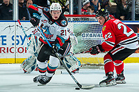 KELOWNA, BC - FEBRUARY 7: Jaydon Dureau #22 of the Portland Winterhawks checks Jake Lee #21 of the Kelowna Rockets in second period at Prospera Place on February 7, 2020 in Kelowna, Canada. (Photo by Marissa Baecker/Shoot the Breeze)