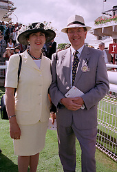 MR & MRS PETER JONES, he is the new chairman of the Tote, at a race meeting in Sussex on 30th July 1997.MAS 126