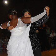 Sheila Dodd, front, and Roke Noir, rear, both of Oakland, California, compete in the same-sex ballroom dancing competition during the 2007 Eurogames at the Waagnatie hangar in Antwerp, Belgium on July 14, 2007. ..Over 3,000 LGBT athletes competed in 11 sports, including same-sex dance, during the 11th annual European gay sporting event. Same-sex ballroom is a growing sports that has been happening in Europe for over two decades.