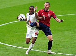 England's Raheem Sterling (left) and Czech Republic's Vladimir Coufal battle for the ball during the UEFA Euro 2020 Group D match at Wembley Stadium, London. Picture date: Tuesday June 22, 2021.