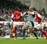 Photo. Chris Ratcliffe, Digitalsport<br /> Arsenal v Stoke City. FA Cup Third Round. <br /> 09/01/2005<br /> Arsenals Jose Antonio Reyes goes through the middle as Jason Jarrett of Stoke tries to stop him.