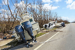 September 13, 2017 - Big Pine, Florida, U.S. - Boats washed across US 1 in Big Pine from a marina on the other side of the road by the storm surge from Hurricane Irma sit up against leafless and broken trees Wednesday. (Credit Image: © Lannis Waters/The Palm Beach Post via ZUMA Wire)