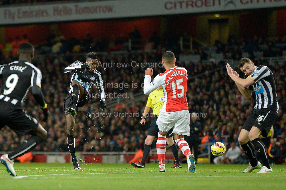 Sammy Ameobi of Newcastle United volleys the ball at goal from outside the box but just misses the goal. Barclays Premier league match, Arsenal v Newcastle Utd at the Emirates Stadium in London on Saturday 13th December 2014.<br /> pic by John Patrick Fletcher, Andrew Orchard sports photography.