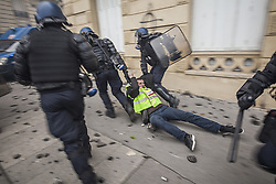 December 8, 2018 - Paris, Paris, France - Police drag and arrest a 'yellow vests' protester during the demonstration along the Avenue des Champs-Elysees in Paris. Without any political affiliation, the 'Yellow Vests' movement rallies in various cities in France this saturday against taxes and rising fuel prices. (Credit Image: © Celestino Arce/NurPhoto via ZUMA Press)