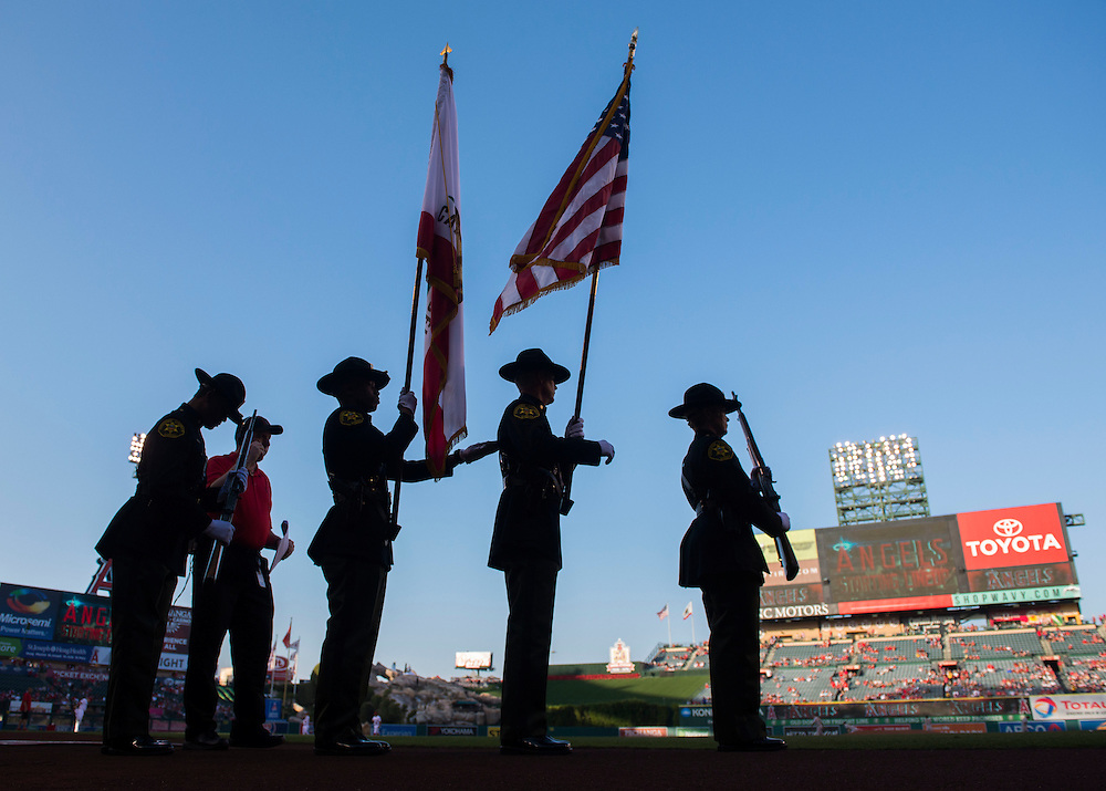 The Orange County Sheriff's Honor Guard prepares to take the field before the Angels' 7-4 loss to Oakland at Angel Stadium on Friday.<br /> <br /> ///ADDITIONAL INFO:   <br /> <br /> angels.0625.kjs  ---  Photo by KEVIN SULLIVAN / Orange County Register  --  6/24/16<br /> <br /> The Los Angeles Angels take on the Oakland Athletics Friday at Angel Stadium.<br /> <br /> <br />  6/24/16