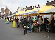 Market stalls in the High Street, Marlborough, Wiltshire, England, UK