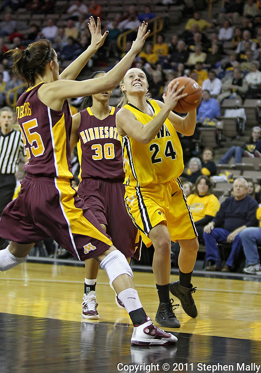 February 10 2011: Iowa Hawkeyes guard Jaime Printy (24) eyes the basket as Minnesota Golden Gophers forward Katie Loberg (25) defends during the first half of an NCAA women's college basketball game at Carver-Hawkeye Arena in Iowa City, Iowa on February 10, 2011. Iowa defeated Minnesota 64-62.