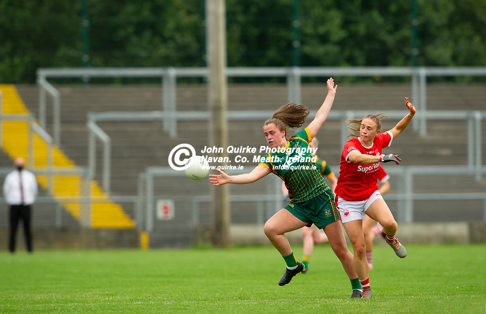 10-07-21. Meath v Cork - LGFA All-Ireland Senior Championship - Group 3 Round 1 at St. Brendan's Park, Birr.<br /> Emma Duggan, Meath in action against Ashling Hutchings, Cork.<br /> Photo: John Quirke / www.quirke.ie<br /> ©John Quirke Photography, 16 Proudstown Road, Navan. Co. Meath. (info@quirke.ie / 046-9028461 / 087-2579454).