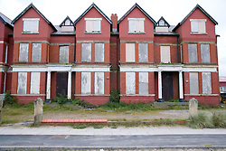 A row of houses boarded up waiting to be demolished for the housing market renewal initiative programme in the Bootle area; Liverpool; England,