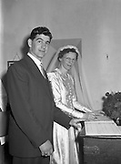 30/03/1957<br /> 03/30/1957<br /> 30 March 1957<br /> Wedding of Lee - Hill at Finglas Parish Church (Church of Ireland) and the Spa Hotel, Lucan, Dublin. Couple signing the register.