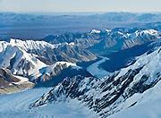 Flightsee over Denali National Park and Preserve, Alaska, USA. See a vast wilderness of glaciers, icy peaks, and mile deep granite gorges in the Alaska Range.