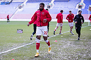 Fleetwood Town defender Janoi Donacien(22)warming up before the EFL Sky Bet League 1 match between Wigan Athletic and Fleetwood Town at the DW Stadium, Wigan, England on 23 January 2021.