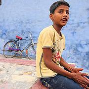 Young boy at Bundi sitting by his bike