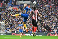 Carlton Morris of Shrewsbury Town (9) and Michael Bostwick of Lincoln City (16) battle for the ball during the EFL Trophy Final match between Lincoln City and Shrewsbury Town at Wembley Stadium, London, England on 8 April 2018. Picture by Stephen Wright.