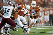AUSTIN, TX - AUGUST 31: David Ash #14 of the University of Texas Longhorns scrambles against the New Mexico State Aggies on August 31, 2013 at Darrell K Royal-Texas Memorial Stadium in Austin, Texas.  (Photo by Cooper Neill/Getty Images) *** Local Caption *** David Ash