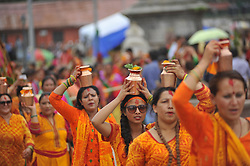 July 24, 2017 - Kathmandu, Nepal - Nepalese devotees hold holy water to offer at the temple during Shrawan Sombar festival at the premises of Pashupatinath Temple, Kathmandu, Nepal on Monday, July 24, 2017. Nepalese devotees fast and worship Lord Shiva to pray for happiness for their families. (Credit Image: © Narayan Maharjan/NurPhoto via ZUMA Press)