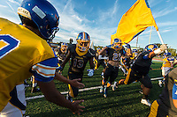 The Del Campo Cougas football team takes the field as they host the Monterey Trail Mustangs Friday Sep 2, 2016.<br /> photo by Brian Baer