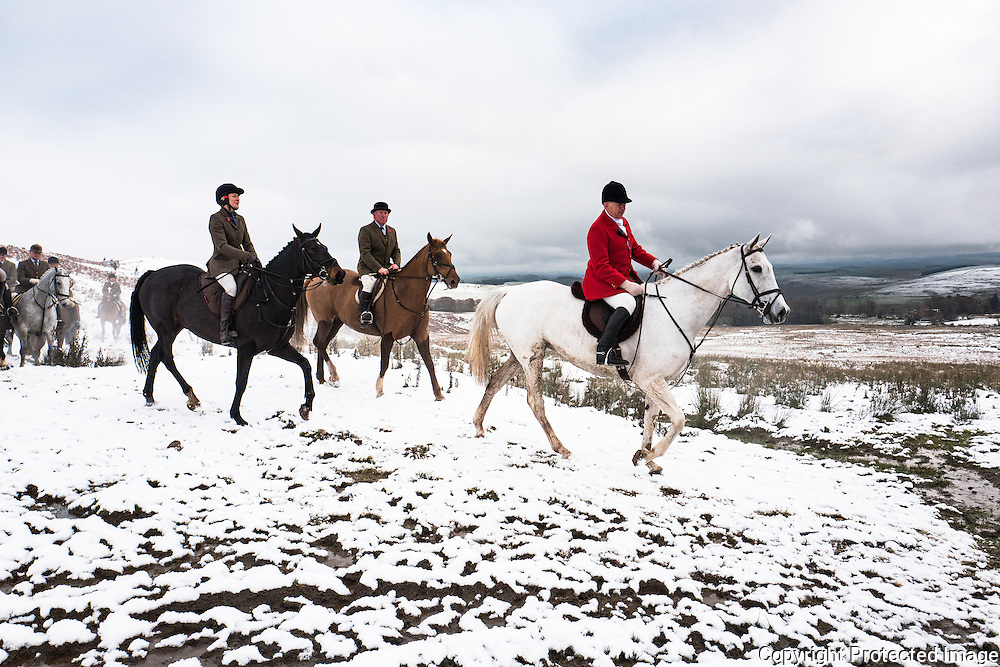Hawick, Scottish Borders, UK. 9th November 2016. Former Olympian Ian Stark MFH leads the field as the Duke of Buccleuch Hunt hold their opening meet in the snow near Hawick in the Scottish Borders. © Chris Strickland / Alamy Live News