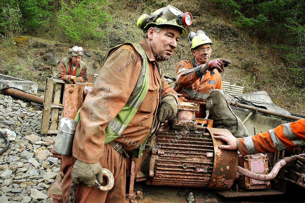 (left to right) Keith Aubrey, 56, Gwyn Evans, 48, Vernon Watkins, 62, some of the miners working to restore Unity Mine are portrayed while discussing a working procedure, on Thursday, Apr. 12, 2007, in Cwmgwrach, Vale of Neath, South Wales. The time is ripe again for an unexpected revival of the coal industry in the Vale of Neath due to the increasing prize and diminishing reserves of oil and gas, the uncertainties of renewable energy sources, and the technological advancement in producing energy from coal while limiting emissions of pollutants, has created the basis for valuable investment opportunities and a possible alternative to the latest energy crisis. Unity Mine, in particular, has started a pioneering effort to revive the coal industry in the area, reopening after more than 8 years with the intent of exploiting the large resources still buried underground. Coal could be then answer to both, access to cheaper and paradoxically greener energy and a better and safer choice than nuclear energy as a major supply for the decades to come. It is estimated that coal reserves in Wales amount to over 250 million tonnes, or the equivalent of at least 50 years of energy supply, while the worldwide total coal could last for over 200 years as a viable resource compared to only a few decades of oil and natural gas.