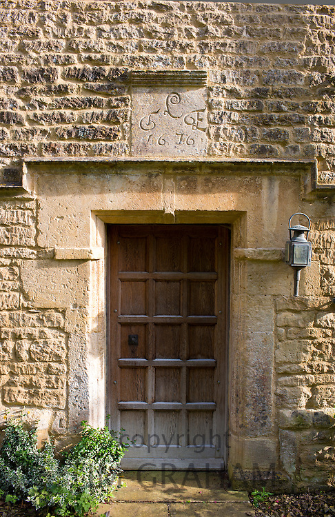 Traditional 17th Century cottage built 1676 of old Cotswold stone at Taynton in The Cotswolds, Gloucestershire, UK