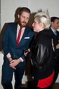 CHRIS SLEVIN; SONYA BARBER, THE LAUNCH OF THE KRUG HAPPINESS EXHIBITION AT THE ROYAL ACADEMY, London. 12 December 2011.