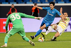 February 21, 2019 - Saint Petersburg, Russia - Zenit St.Petersburg's Iranian forward Sardar Azmounin (C) vies for the ball during the UEFA Europa League round of 32 second leg football match between FC Zenit and Fenerbahce SK in Saint Petersburg on February 21, 2019. (Credit Image: © Igor Russak/NurPhoto via ZUMA Press)