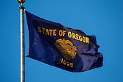 USA, Oregon, Salem, State Capitol State Park, Oregon state flag.