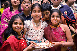 Group of children and young people celebrating Navratri; the Hindu festival of Nine Nights,