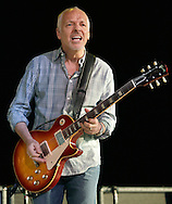 Peter Frampton, center, and his band perform at Bethel Woods Center for the Arts on Friday, June 18, 2010.