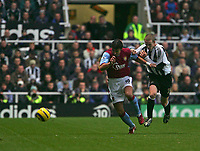Photo: Andrew Unwin.<br />Newcastle Utd v Aston Villa. The Barclays Premiership.<br />03/12/2005.<br />Aston Villa's Milan Baros (L) tries to get away from Newcastle's Peter Ramage (R).