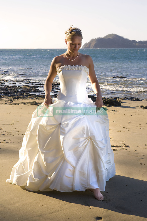 July 21, 2019 - Woman In Wedding Dress On Beach (Credit Image: © Caley Tse/Design Pics via ZUMA Wire)