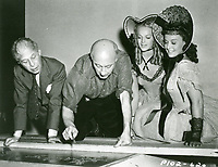 1941 Cecil B DeMille with Sid Grauman at his hand and footprint ceremony at the Chinese Theatre