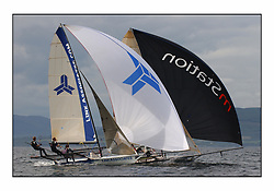 The 2004 Skiff Nationals at Largs held by the SSI.<br /> <br /> Link Associates helmed by Tim Penfold.<br /> SP Systems helemd by Richard Hall.<br /> <br /> Marc Turner / PFM Pictures