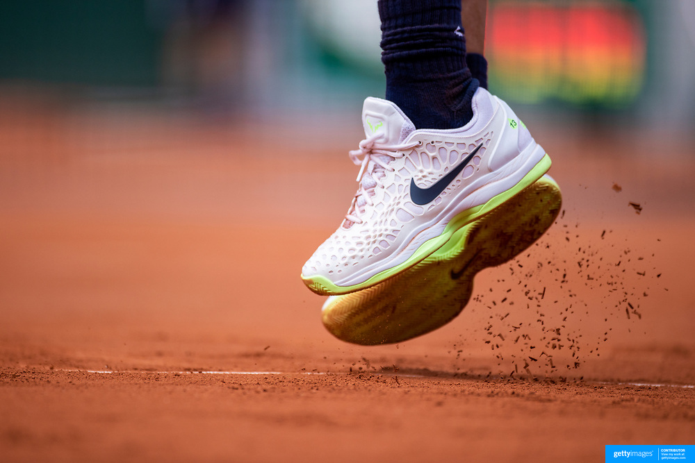 PARIS, FRANCE June 9. The feet of  Rafael Nadal of Spain while serving against Diego Schwartzman of Argentina on Court Philippe-Chatrier during the quarter finals of the singles competition at the 2021 French Open Tennis Tournament at Roland Garros on June 9th 2021 in Paris, France. (Photo by Tim Clayton/Corbis via Getty Images)