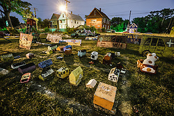 Heidelberg Project at night, Detroit, Michigan.  The Heidelberg Project is a grass roots project started by artist Tyree Guyton that uses art to help revitalize the embattled neighborhood.  Each year, over 275,000 people visit the project .  For more information, go to www.heidelberg.org