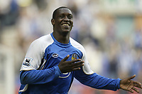 Photo: Aidan Ellis.<br /> Wigan Athletic v Reading. The Barclays Premiership. 26/08/2006.<br /> Wigan's Emile Heskey celebrates his goal and the first of the game