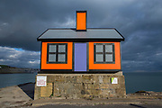 An orange bungalow on the edge of Folkestone harbour built by the artist Richard Woods as part of the 2017 Folkestone Triennial. Folkestone, Kent. The artist wanted to create a piece about the housing crisis in the UK.  (photo by Andrew Aitchison / In pictures via Getty Images)