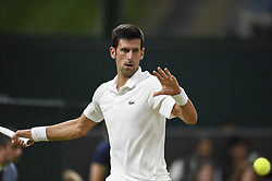 LONDON, July 14, 2018  Novak Djokovic of Serbia hits a return during the men's singles semifinal match against Rafael Nadal of Spain at the Wimbledon Championships 2018 in London, Britain, on July 13, 2018. The match was suspended due to the time issue. (Credit Image: © Stephen Chung/Xinhua via ZUMA Wire)
