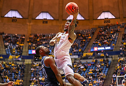 Dec 1, 2019; Morgantown, WV, USA; West Virginia Mountaineers forward Derek Culver (1) shoots during the second half against the Rhode Island Rams at WVU Coliseum. Mandatory Credit: Ben Queen-USA TODAY Sports