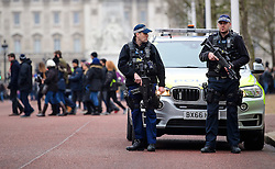 © Licensed to London News Pictures. 31/12/2016. London, UK. Armed police watch over `changing of the guard at Buckingham Palace in Westminster, London ahead of tonight's New Year celebrations. Security surrounding this year's event has been heightened following a terrorist attack at a Christmas market in Berlin earlier this month. Photo credit: Ben Cawthra/LNP